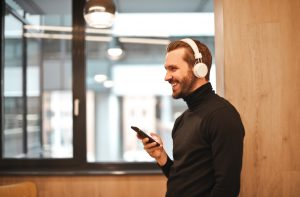 Man enjoying user experience through wireless music powered by apps